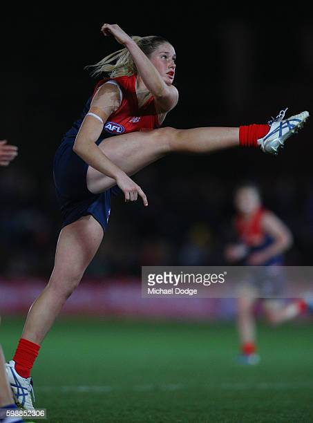 Tayla Harris of the Demons kicks a goal during the AFL Women's Exhibition Match between the Western Bulldogs and the Melbourne Demons at Whitten Oval...