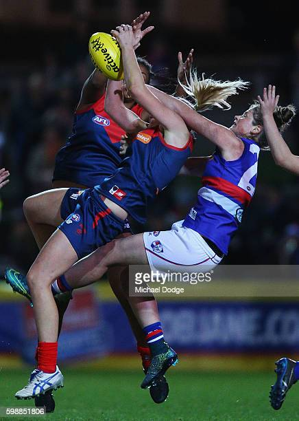 Tayla Harris of the Demons marks the ball during the AFL Women's Exhibition Match between the Western Bulldogs and the Melbourne Demons at Whitten...
