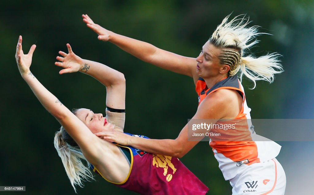 Tayla Harris of the Lions in action with Renee Tomkins of the Giants during the round four Women's AFL match between the Brisbane Lions and the Greater Western Sydney Giants at South Pine Complex on February 25, 2017 in Brisbane, Australia.