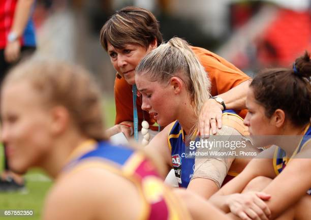Tayla Harris of the Lions is consoled by Jan Cooper during the 2017 AFLW Grand Final match between the Brisbane Lions and the Adelaide Crows at...