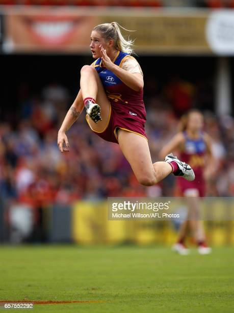 Tayla Harris of the Lions kicks the ball during the 2017 AFLW Grand Final match between the Brisbane Lions and the Adelaide Crows at Metricon Stadium...