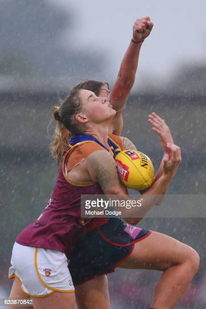 Tayla Harris of the Lions marks the ball against Katherine Smith of the Demons during the round one Women's AFL match between the Melbourne Demons...