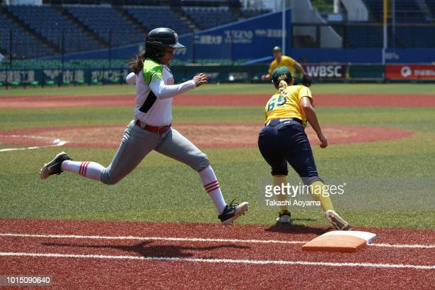 Taylah Ashleigh Tsitsikronis of Australia catches a throw at first base as Brigette Deann Delponte Gordoa of Mexico is forced out during the eighth...