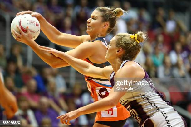Taylah Davies of the Giants and Gabi Simpson of the Firebirds compete for the ball during the round eight Super Netball match between the Firebirds...