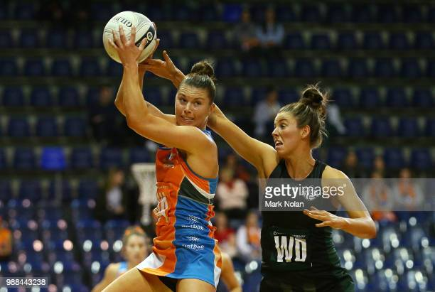 Taylah Davies of the Giants and Melissa Bragg of the Magpies contest possession during the Australian Netball League grand final between the...