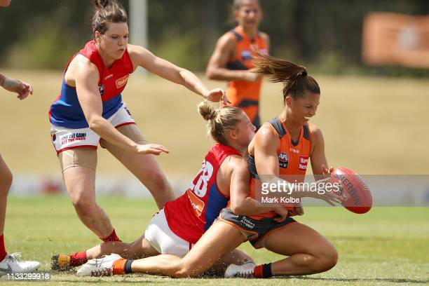 Taylah Davies of the Giants is tackled by Tyla Hanks of the Demons during the round five AFLW match between the Greater Western Sydney Giants and the...