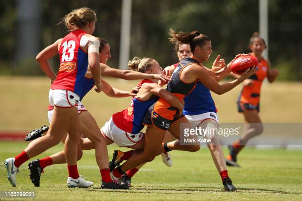 Taylah Davies of the Giants is tackled during the round five AFLW match between the Greater Western Sydney Giants and the Melbourne Demons at...