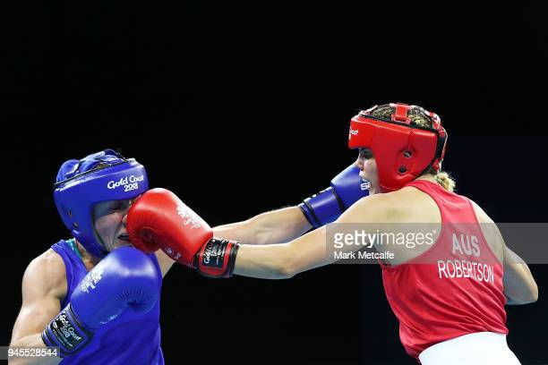 Taylah Robertson of Australia and Lisa Whiteside of England compete in their Women's Fly 4851kg Semifinal bout during Boxing on day nine of the Gold...