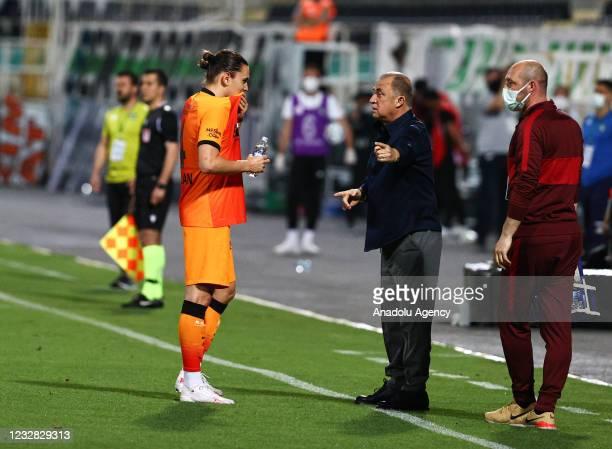 Taylan Antalyali of Galatasaray receives tactics from head coach Fatih Terim during the Turkish Super Lig week 41 match between Yukatel Denizlispor...