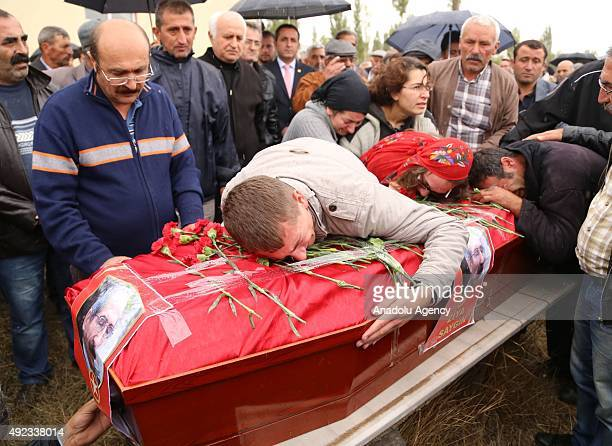 Taylan Saygin, son of Ziya Saygin, manager of Peoples' Democratic Party's in Gebze district, killed in suicide bombings in Ankara, mourns during his...