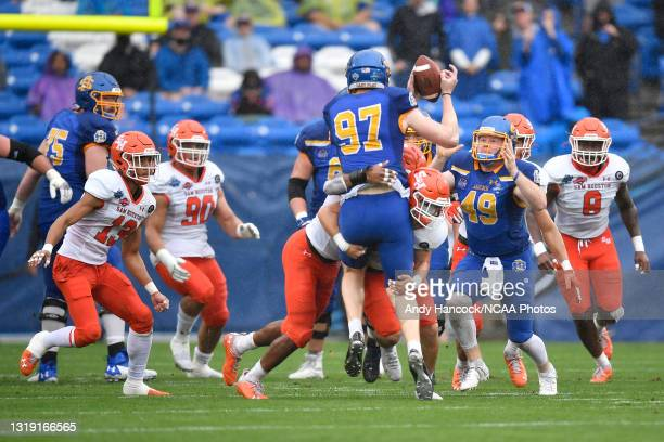 Taylen Blaylock of the Sam Houston State Bearkats tackles Cole Frahm of the South Dakota State Jackrabbits during the Division I FCS Football...