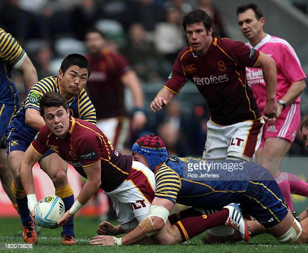 Tayler Adams of Southland looks to offload the ball during the round seven ITM Cup match between Otago and Southland at Forsyth Barr Stadium on...
