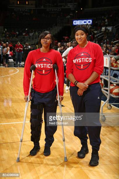 Tayler Hill and Tianna Hawkins of the Washington Mystics are seen before the postponed game against the Connecticut Sun on July 28 2017 at the...