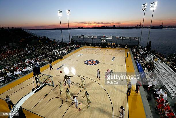 Tayler Hill of the Ohio State Buckeyes attempts a shot against the Notre Dame Fighting Irish during the Walmart Carrier Classic on the deck of the...