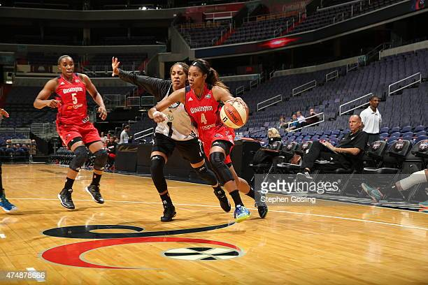 Tayler Hill of the Washington Mystics drives against the Minnesota Lynx during an Analytic Scrimmage at the Verizon Center on May 26 2015 in...