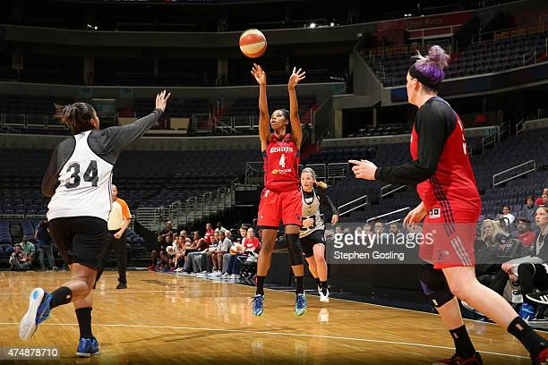 Tayler Hill of the Washington Mystics shoots against the Minnesota Lynx during an Analytic Scrimmage at the Verizon Center on May 26 2015 in...