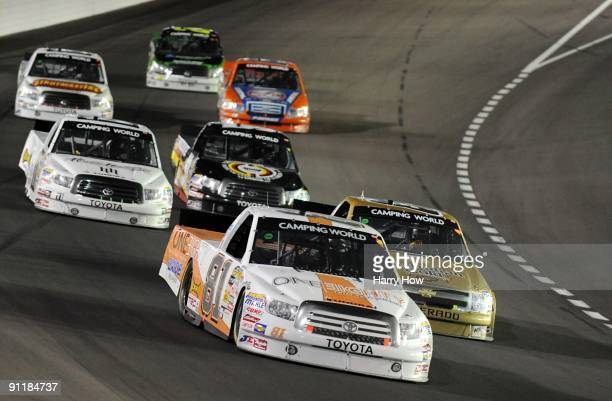 Tayler Malsam driver of the OneEighty Toyota leads a group of trucks during the NASCAR Camping World Truck Series Las Vegas 350 at Las Vegas Motor...