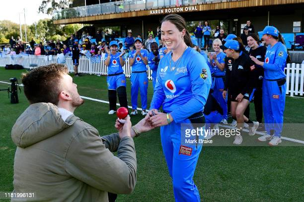 Tayler McKechnie proposes to Amanda Wellington of the Adelaide Strikers to the joym of her team mates during the Women's Big Bash League match...