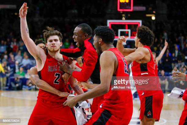 Tayler Persons of the Ball State Cardinals looks into the Notre Dame Fighting Irish student section after sinking the game winning basket against the...