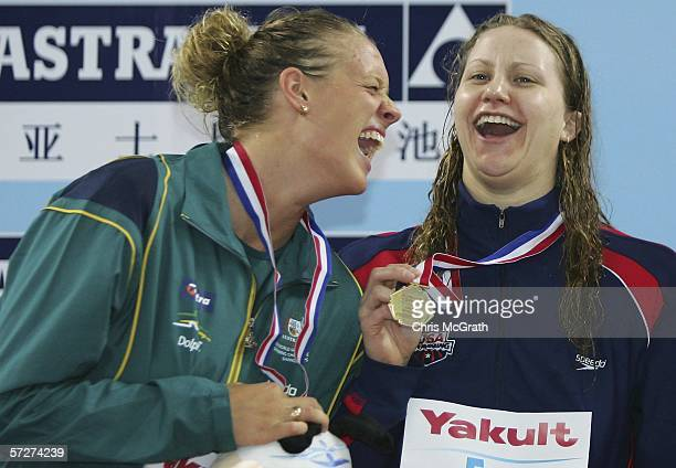 Tayliah Zimmer of Australia and Margaret Hoelzer of the USA joke around during the medal ceremony for the Women's 200m backstroke final during day...