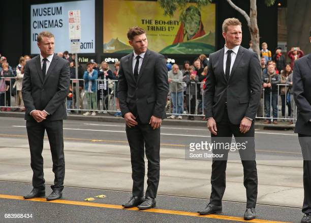 Taylor Adams and Nathan Buckley coach of the Magpies along with Collingwood players form a guard of honour as the coffin of Lou Richards leaves the...