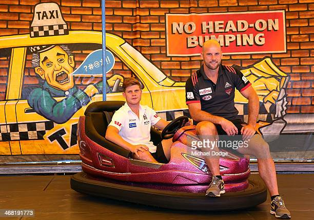 Taylor Adams of the Collingwood Magpies and Paul Chapman of the Essendon Bombers pose on a Dodgem Car during the 2014 NAB Challenge Launch at...