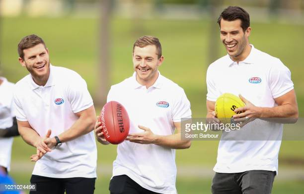 Taylor Adams of the Magpies Devon Smith of the Bombers and Alex Rance of the Tigers look on during a 'Fit For Footy' launch at Gosch's Paddock on...