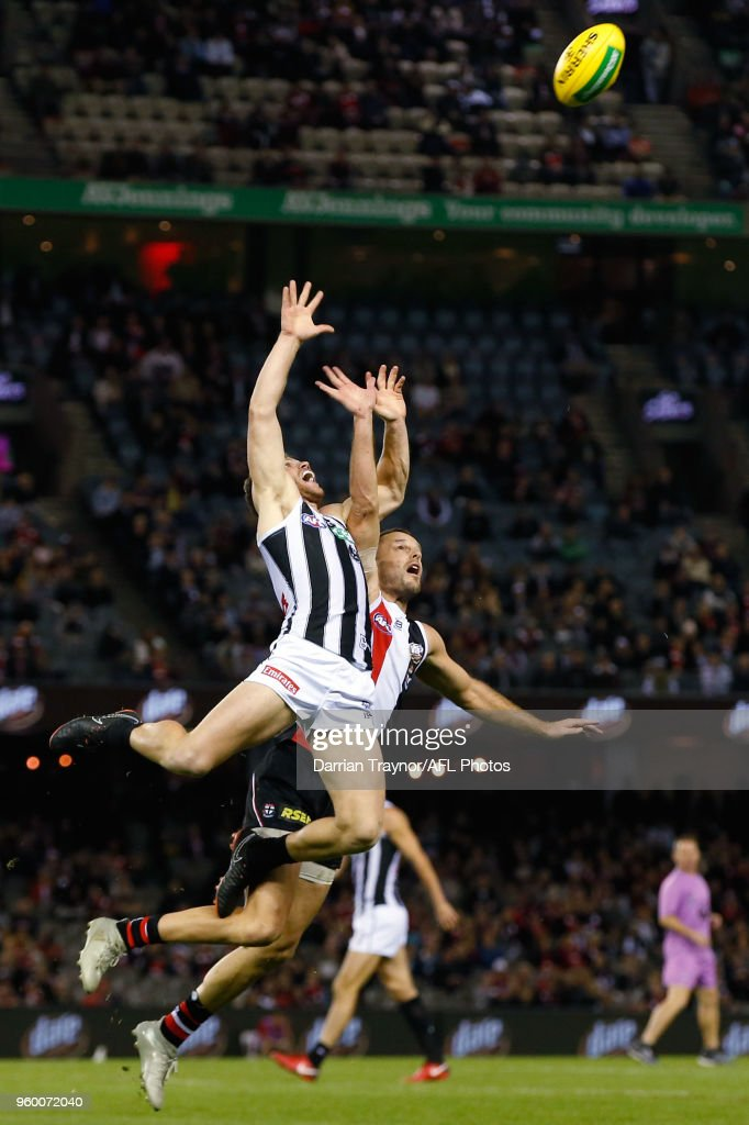 Taylor Adams of the Magpies leaps for the ball in front of Nathan Brown during the round nine AFL match between the St Kilda Saints and the Collingwood Magpies at Etihad Stadium on May 19, 2018 in Melbourne, Australia.