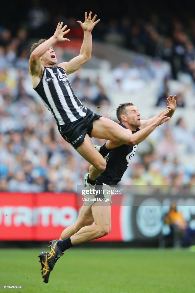 Taylor Adams of the Magpies marks the ball high over Sam Docherty of the Blues during the round seven AFL match between the Collingwood Magpies and the Carlton Blues at Melbourne Cricket Ground on May 6, 2017 in Melbourne, Australia.