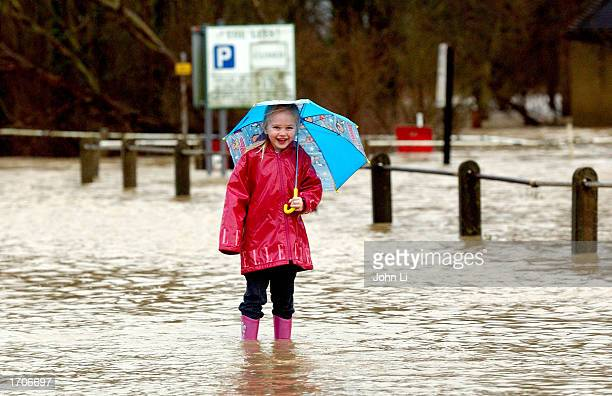 Taylor Amschwand wades through flooded roads in the village of Yalding Kent January 2 2003 in Yalding According to the United Kingdom's Environment...
