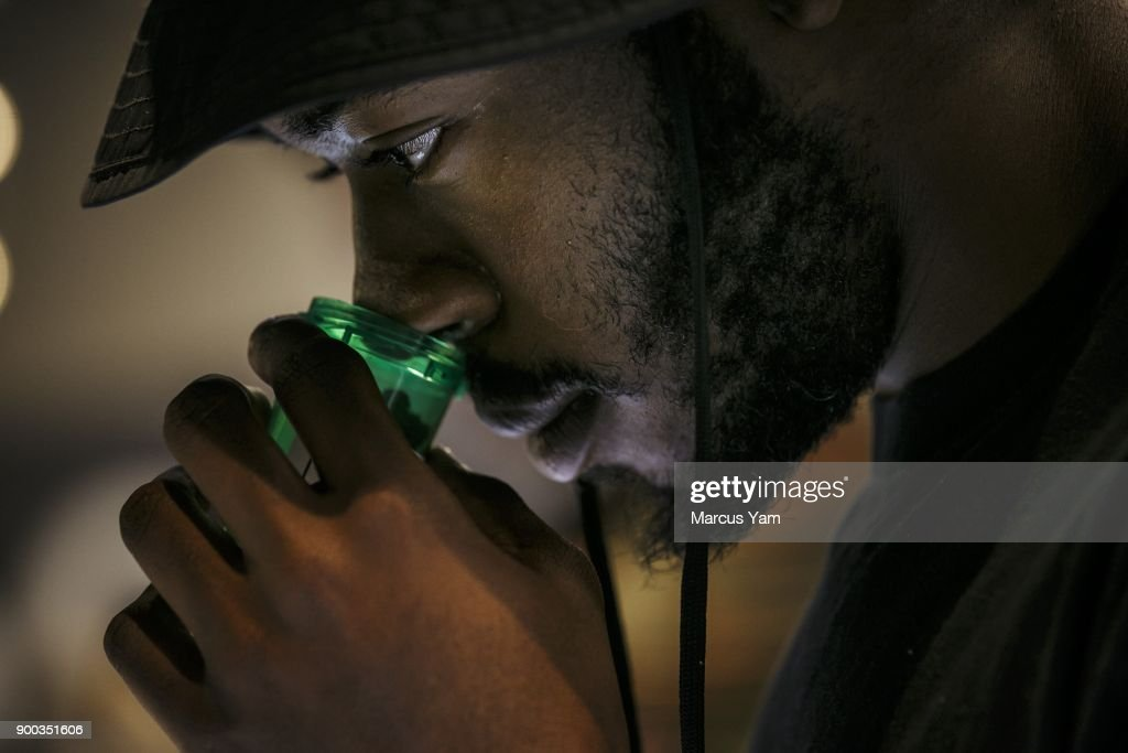 Taylor Anthony, from New York, takes a whiff of the pot products showcased for sale at 420 Central during the first day of legal recreational pot sales in Santa Ana, Calif., on Jan. 1, 2018. The state has issued dozens of permits for retailers to begin recreational sales this week, expanding a market that is expected to grow to $7 billion annually by 2020. Several of those retailers are in West Hollywood, but they won't open until Tuesday at the city's request. That makes Santa Ana's licensed stores the closest option for Angelenos who want to buy recreational marijuana on New Year's Day. Buyers could also trek to San Diego or the Palm Springs area to purchase pot.