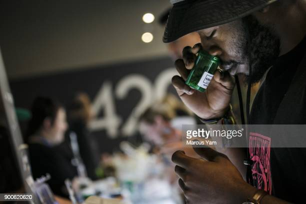 Taylor Anthony from New York takes a whiff of the pot products showcased for sale at 420 Central during the first day of legal recreational pot sales...