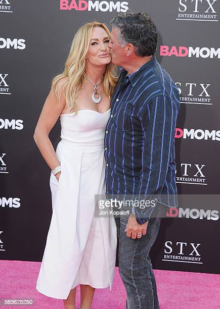 Taylor Armstrong and husband John H Bluher arrive at the Los Angeles Premiere Bad Moms at Mann Village Theatre on July 26 2016 in Westwood California