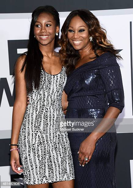 Taylor Ayanna Crawford and singer Yolanda Adams pose in the press room during the BET AWARDS '14 at Nokia Theatre LA LIVE on June 29 2014 in Los...