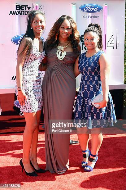 Taylor Ayanna Crawford singer Yolanda Adams and guest attend the BET AWARDS '14 at Nokia Theatre LA LIVE on June 29 2014 in Los Angeles California