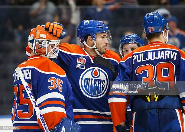 Taylor Beck confers with goaltender Eetu Laurikainen of the Edmonton Oilers after defeating the Calgary Flames on September 26 2016 at Rogers Place...