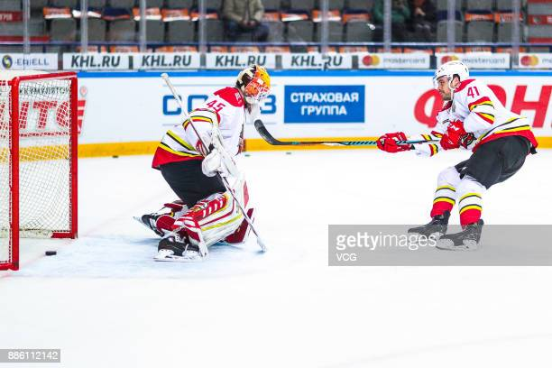 Taylor Beck of HC Kunlun Red Star competes during the 2017/18 Kontinental Hockey League KHL Regular Season match between Amur Khabarovsk and HC...