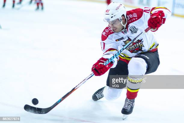 Taylor Beck of HC Kunlun Red Star hits the puck during the 2017/18 Kontinental Hockey League KHL Regular Season match between HC CSKA Moscow and HC...