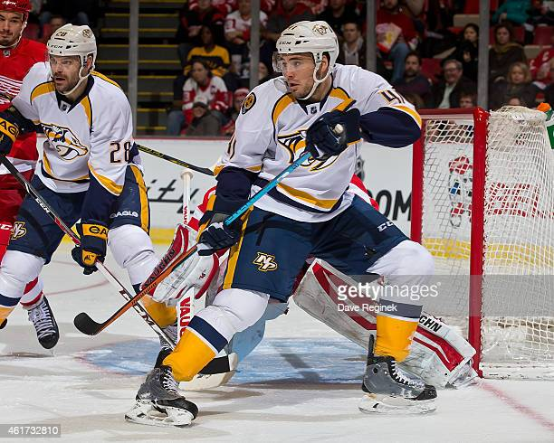 Taylor Beck of the Nashville Predators crashes the net during a NHL game against the Detroit Red Wings on January 17 2015 at Joe Louis Arena in...