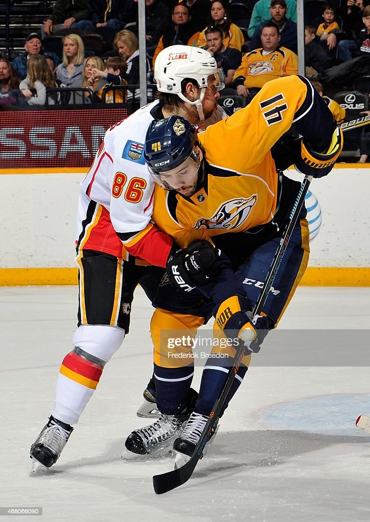 Taylor Beck #41 of the Nashville Predators skates against Josh Jooris #86 of the Calgary Flames during the third period at Bridgestone Arena on March 29, 2015 in Nashville, Tennessee.