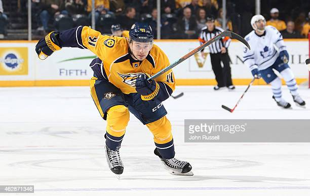 Taylor Beck of the Nashville Predators skates against the Toronto Maple Leafs during an NHL game at Bridgestone Arena on February 3 2015 in Nashville...
