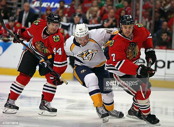 Taylor Beck of the Nashville Predators tries to get between Kimmo Timonen and Brent Seabrook of the Chicago Blackhawks in Game Three of the Western...