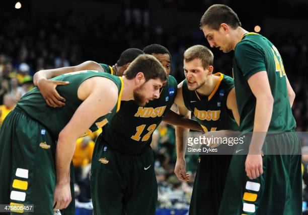 Taylor Braun of the North Dakota State Bison huddles up his team during the first half of the game against the Oklahoma Sooners during the second...
