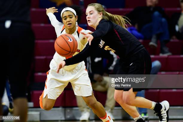 Taylor Brown of the Princeton Tigers and Madeline Raster of the Harvard Crimson vie for the ball during the third quarter of an Ivy League semifinal...