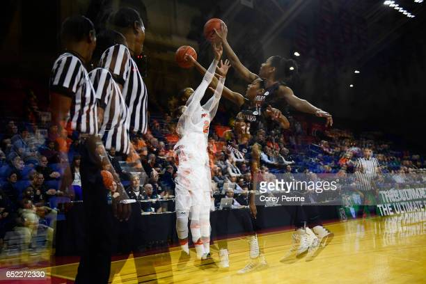 Taylor Brown of the Princeton Tigers has her ball swatted by Taylor Rooks of the Harvard Crimson during the fourth quarter of an Ivy League semifinal...