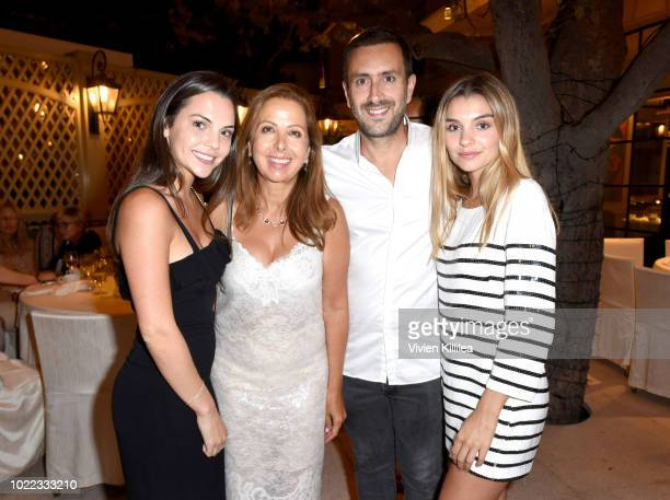 Taylor Burke Karine Ohana Michael Azoulay and Lauren Burke attend Ohana Co LA Event Brands With Mission at The Peninsula Beverly Hills on August 23...