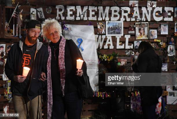 Taylor Carrington and Maggie Carrington both of Nevada hold candles during a vigil put together by the Route 91 Foundation at the Las Vegas Community...
