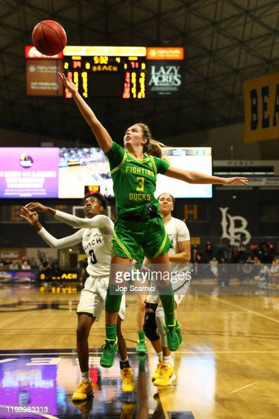 Taylor Chavez of the Oregon Ducks makes a layup in the fourth quarter as Ma'Qhi Berry of Long Beach State runs up for the rebound at Walter Pyramid...