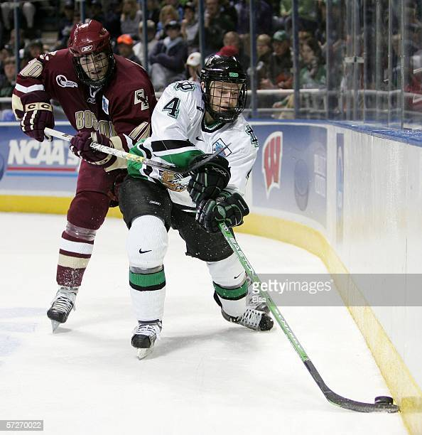 Taylor Chorney of the North Dakota Fighting Sioux attempts to control the puck against Brian Boyle of the the Boston College Eagles during the NCAA...