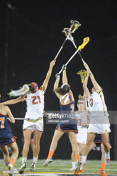 Taylor Cummings of the Maryland Terrapins pulls down a face off over Kailah Kempney of the Syracuse Orange during the NCAA Women's Lacrosse Final at...